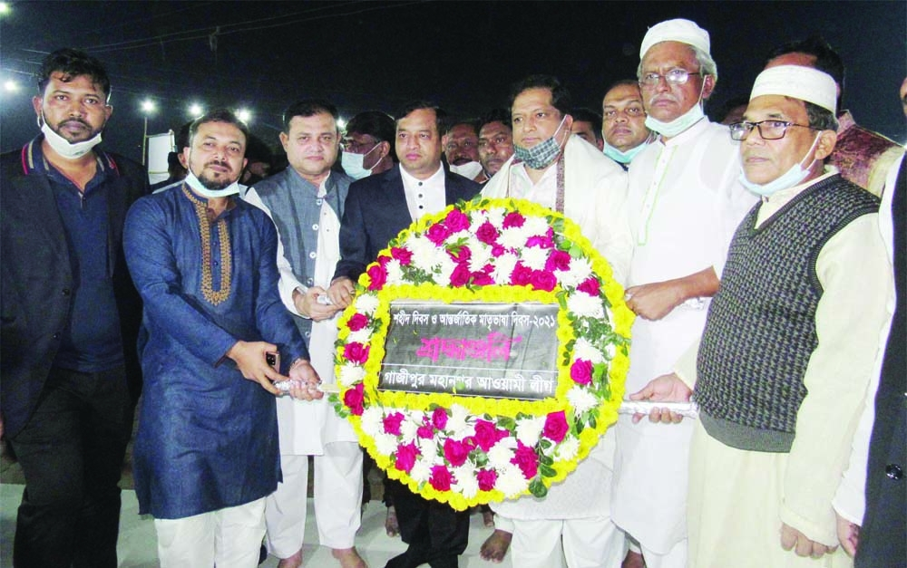 State Minister for Youth and Sports Zahid Ahsan Russell along with Gazipur City Corporation Mayor Jahangir Alam pay tributes to the martyrs of the historic language movement by placing wreaths at the Central Shaheed Minar in Gazipur on Sunday.