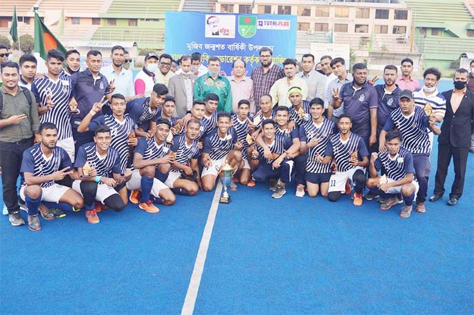 Members of Bangladesh Navy, the champions in the 'Mujib Borsho' Shaheed Smriti Hockey Competition with the chief guest President of Bangladesh Hockey Federation (BHF) and Air Chief Marshal Masihuzzaman Serniabat and the other officials of BHF pose for a photo session at the Maulana Bhashani National Hockey Stadium on Saturday.