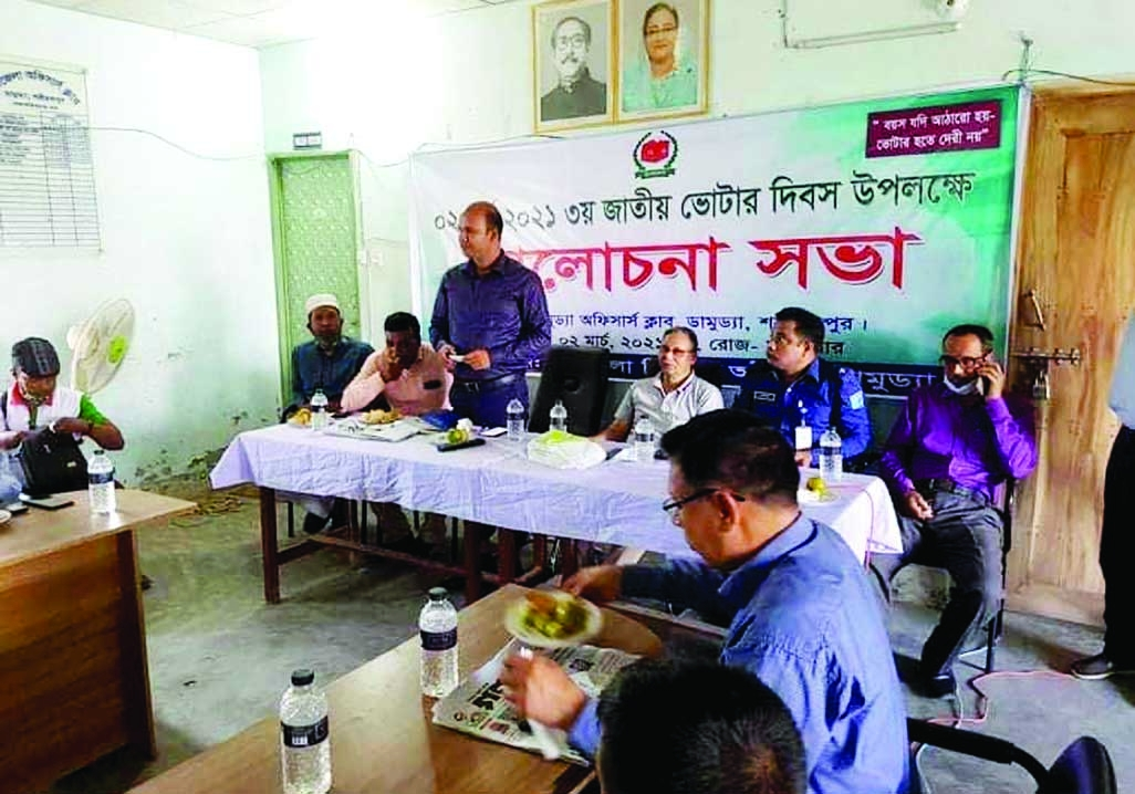 Alamgir Hossain Majhi, Chairman of Damudya Upazila Parishad in Shariatpur district, attends a discussion meeting as chief guest on Tuesday marking the National Voters' Day 2021