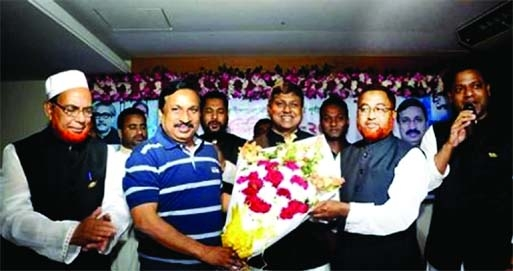 Nizam Uddin Hazari, MP, General Secretary of Feni District Awami League, was greeted with flower bouquet by the party's Sadar Upazila President Karim Ullah and during a meeting on Monday.