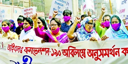 National Workers Unity centre bring out a procession chanting various demands of women marking the International Women's Day at Topkhana Road in the capital on Friday.