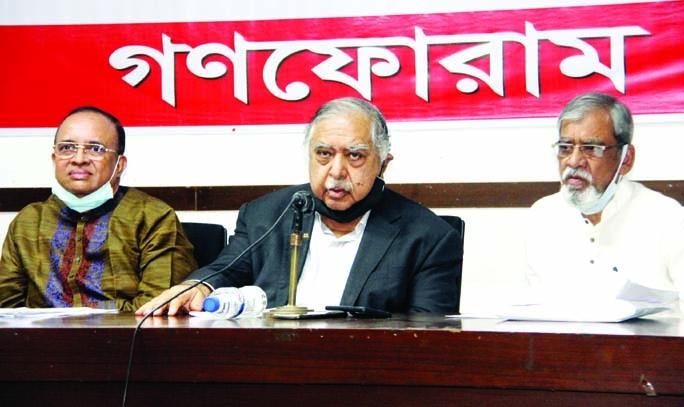 Ganoforum President Dr. Kamal Hossain speaks at a press conference at the Jatiya Press Club on Saturday.