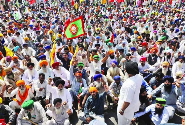 On 100 th day Indian farmers block highway outside Delhi