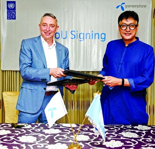 Jens Becker, acting CEO and CFO of Grameenphone (GP) and Sudipto Mukerjee, Resident Representative of UNDP Bangladesh, exchanging document after signing a MoU to collaborate on exploring avenues and potential program designs to accelerate the nation's future economic growth by enhancing the skills and potential of Bangladesh's massive young population dividend at GP office in the city recently. High officials from both organizations were present.