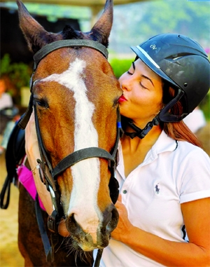 Jacqueline goes horse riding next morning after shoot wrap