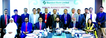 Khondoker Rashed Maqsood, Managing Director & CEO of Standard Bank Limited (SBL), poses for photo session with the participants of the bank's