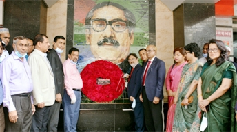 A team led by Md Obaid Ullah Al Masood, Managing Director and CEO of Rupali Bank Limited, paying homage to the portrait of Bangabandhu Sheikh Mujibur Rahman on the occasion of historic 7 March at the bank's head office premises on Sunday.