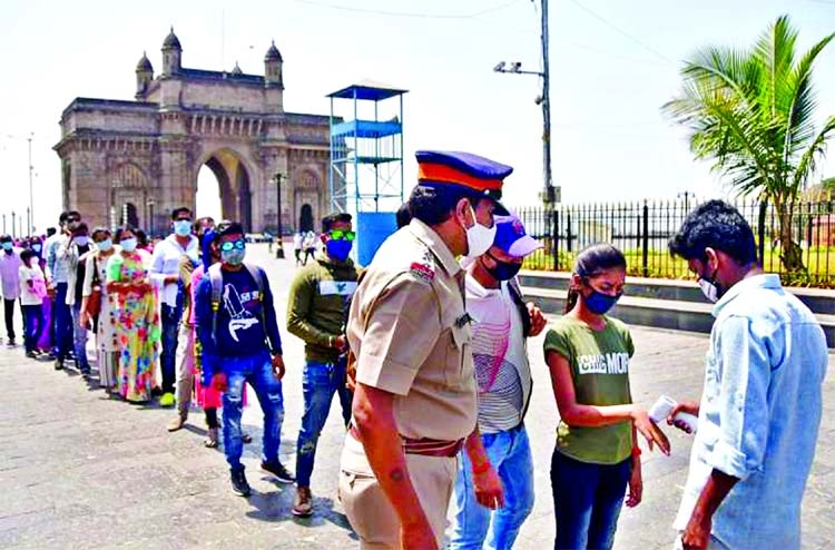 India's daily COVID-19 cases surpass 1 lakh mark for first time