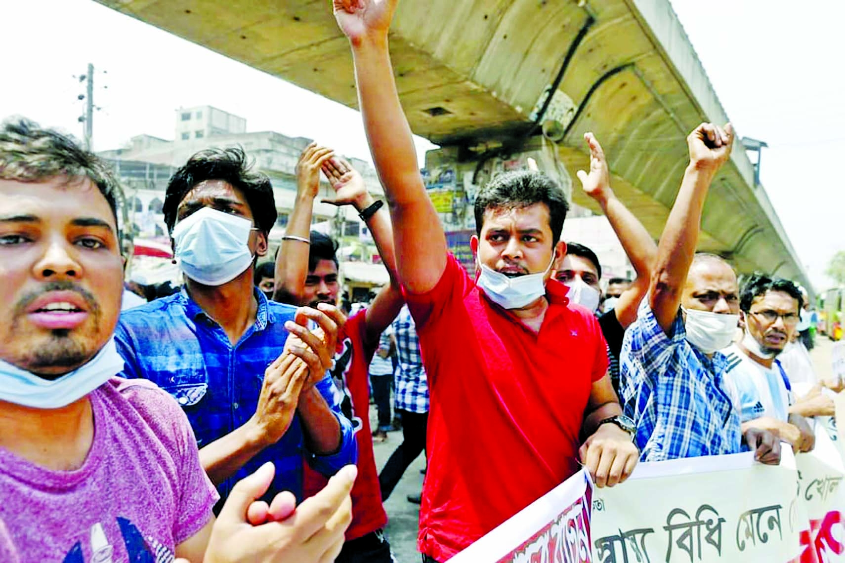Shop owners and employees demonstrate at Bangobazar, Fulbaria and other parts of the city with call to the government on Wednesday to withdraw ban imposed on Monday due to tackle Corona pendemic.