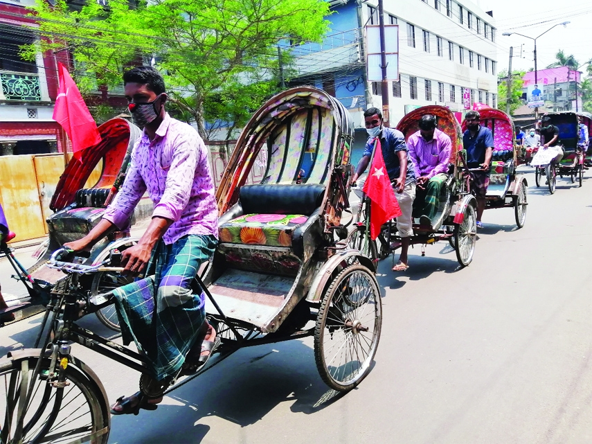 Rickshaw procession in Barisal demanding relief, ration