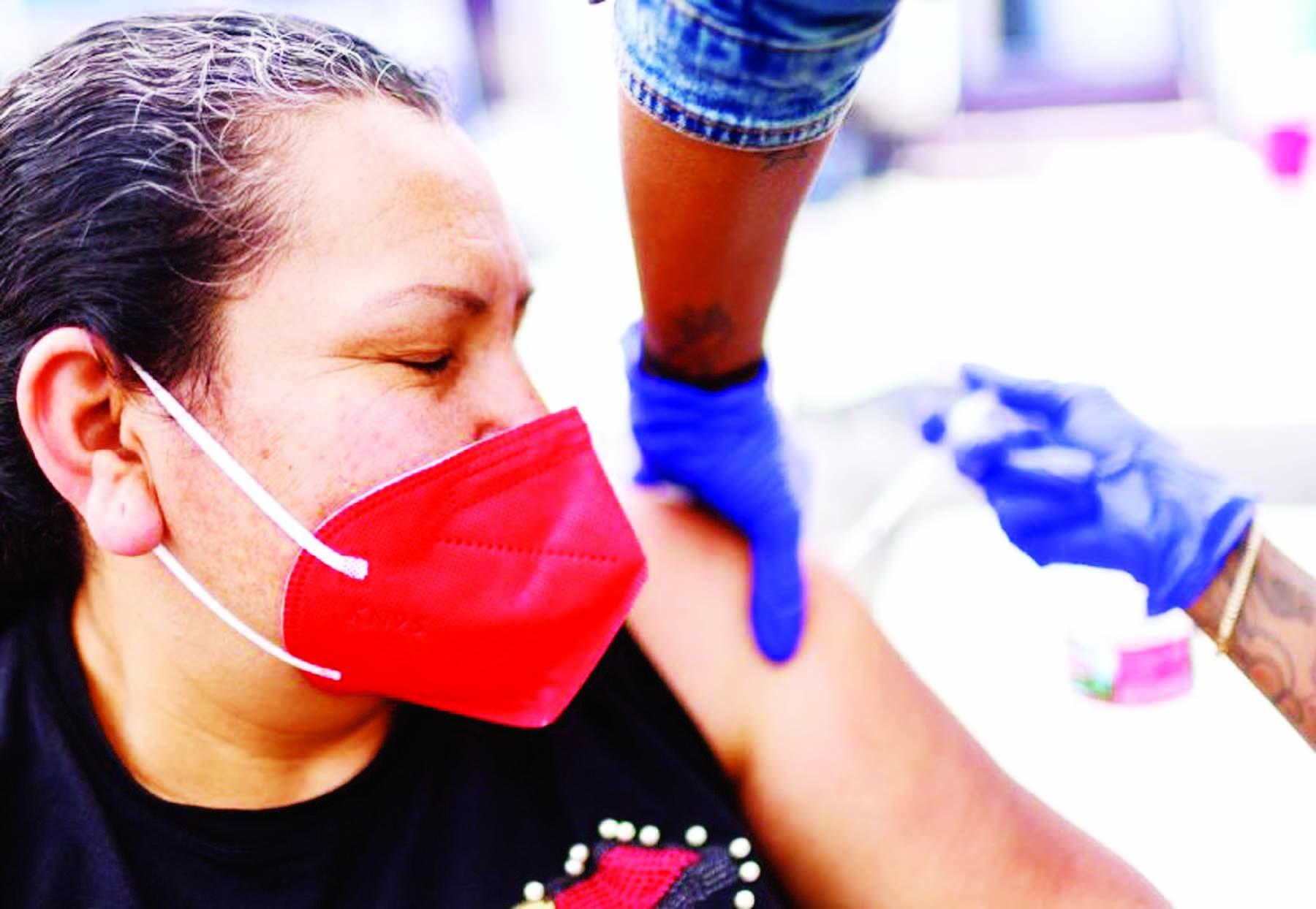 US hits vaccine milestone as New Zealand, Australia open travel bubble
