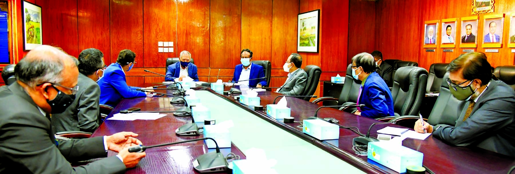 Morshed Alam, MP, Chairman of the Board of Directors of Mercantile Bank Limited, presiding over a discussion meeting with the Divisional Heads of the head office at the bank's board room on Sunday. Md. Quamrul Islam Chowdhury, Managing Director & CEO and senior officials of the bank were present.