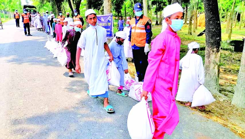 Patuakhali Coast Guard in collaboration with Vidyananda Zakat Foundation distributes relief goods among 200 helpless destitute children at Baufal of Patuakhali on Saturday.