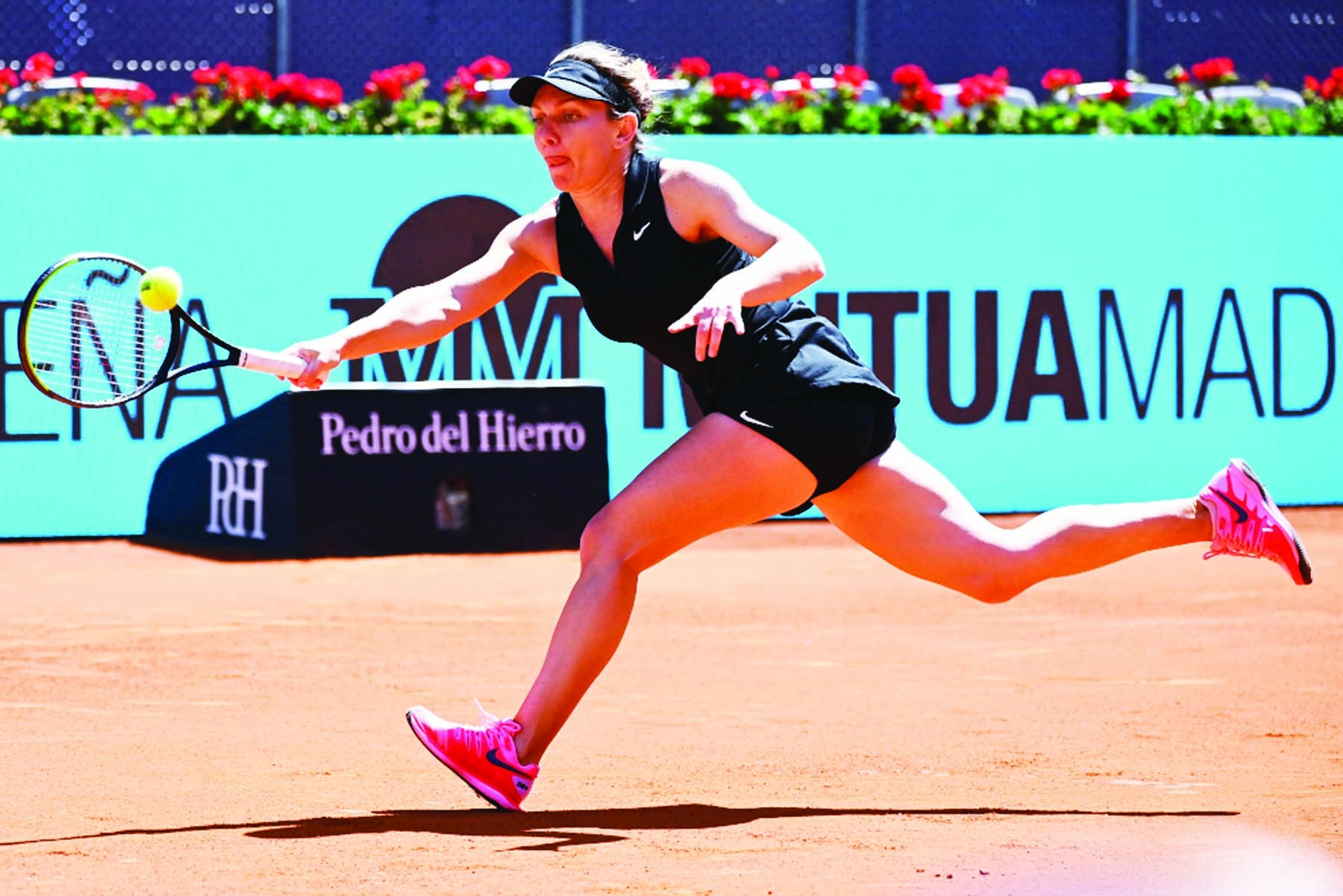 Halep knocked out of Madrid Open, Thiem cruises through