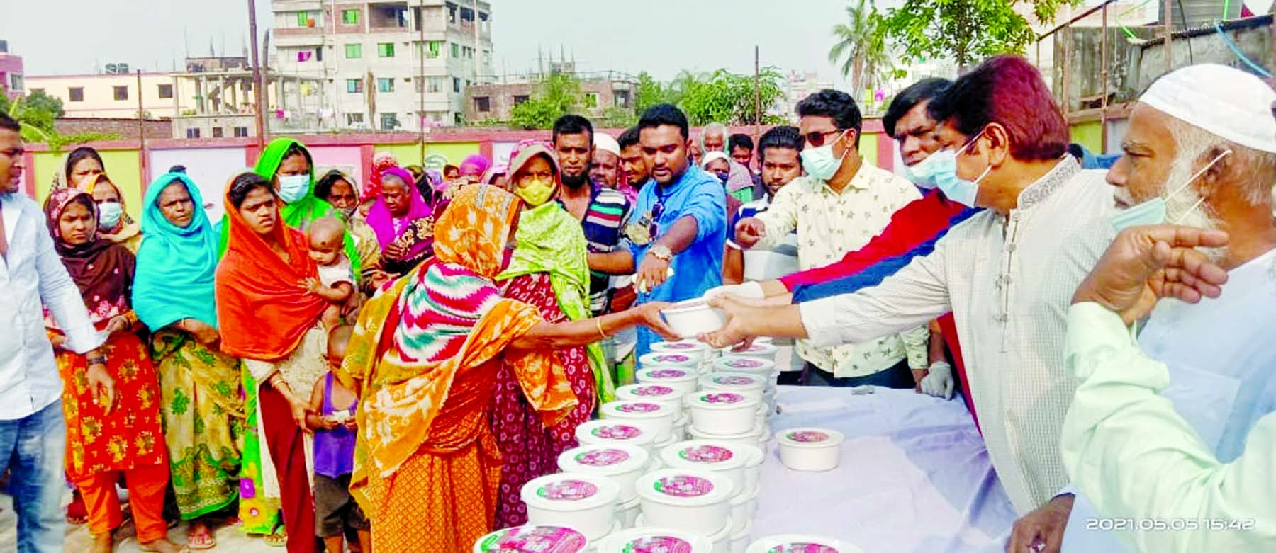 Senior Vice-President of Dhaka Mahanagar Dakshin Awami Juba League Ahmed Ullah Madhu distributes relief materials among the poor at Bamoil Eidgah field in the city on Wednesday. DSCC Mayor Barrister Sheikh Fazle Nur Taposh and Chairman of Bangladesh Awami Juba League Sheikh Fazle Shams Parosh assisted the programme.