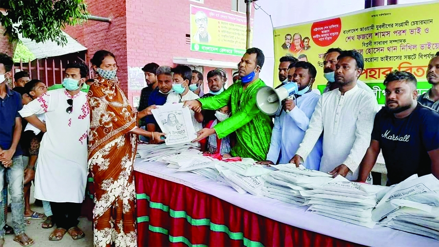 Leaders and activists of Bangladesh Jubo League, Mymensingh Mohanagar unit distribute The Prime Minster's gift of Eid clothes among 100 male, female and children at Mymensingh Railway Station on Wednesday.