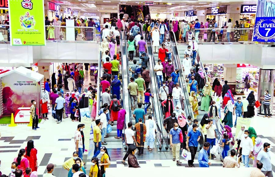 Bashundhara City Shopping Mall in the capital witnesses a huge crowd of shoppers on Thursday ahead of the Eid-ul-Fitr festival.