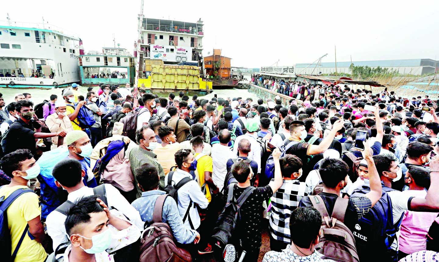 Eid home-goers flock recklessly to Munshiganj's Shimulia ferry terminal on Sunday.