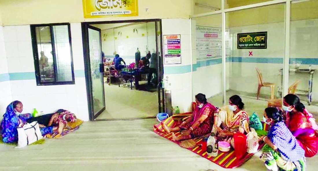 Family members are seen waiting at the yellow zone of Khulna dedicated corona hospital for their near and dear ones who are undergoing treatment for Covid-19. This photo was taken on Wednesday.