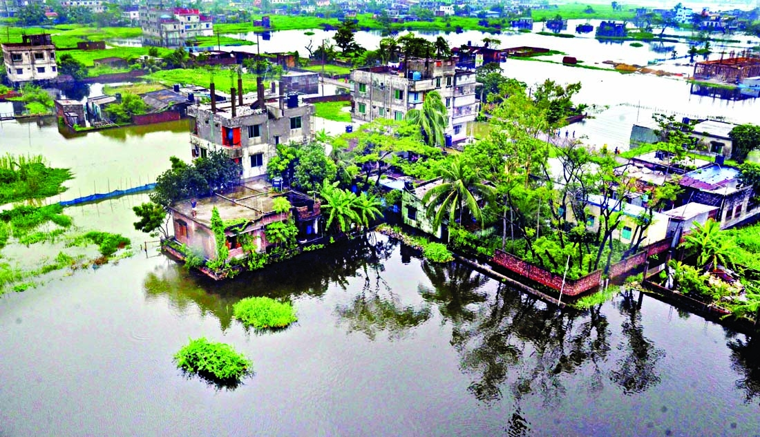 Continuous rain in the past few days has created waterlogging in the Dhaka-Narayanganj-Demra (DND) dam area. The aerial view of this photo shows that a large part of Matuail at Demra in the capital inundates due to inadequacies of the drainage system.