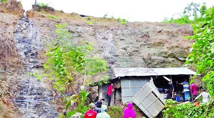 Chattogram district administration conducts an eviction drive against the people who live illegally at foothill risking death in landslides at Linkroad area of Baizid Fouzdarhat on Monday.