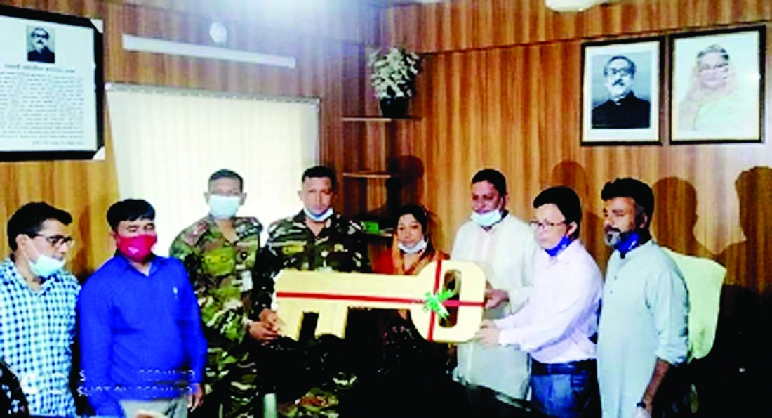 Keys of 140 dwelling houses built under care and supervision of Armed Forces for the poor, landless and river eroded families at New Char Ashrayan Project, a remote char in Nilkomol union, being handed over to Haimchar Upazila Parishad Chairman Noor Hossain Patwary and UNO Chai Thoaila Chowdhury at a ceremony at Upazila Parishad recently. Major Tasnim Farhan of Cumilla Cantonment handed over the keys.  Upazila Vice Chairperson Shahnaj Begum, Project Implementation officer and concerned others   were present at that time. The new houses will be handed over to the owners shortly.