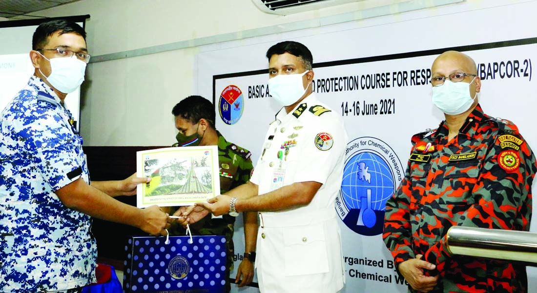 Director General (CMR), Armed Forces Division Commodore Arif Ahmed Mostafa distributes certificates among the participants in a training workshop on 'Rescue operation in chemical fire accident' in the city on Wednesday.