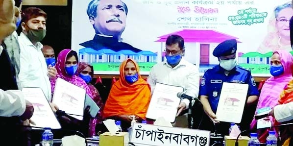 In the second phase of handing over homes to the landless people on the occasion of birth centenary of Bangabandhu Sheikh Mujibur Rahman, a total of 2,619 families in Chapainababganj receive keys of the homes along with deeds of the land on Sunday.