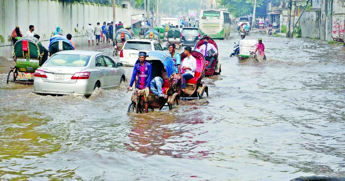 15 minute rain swamps parts of Dhaka