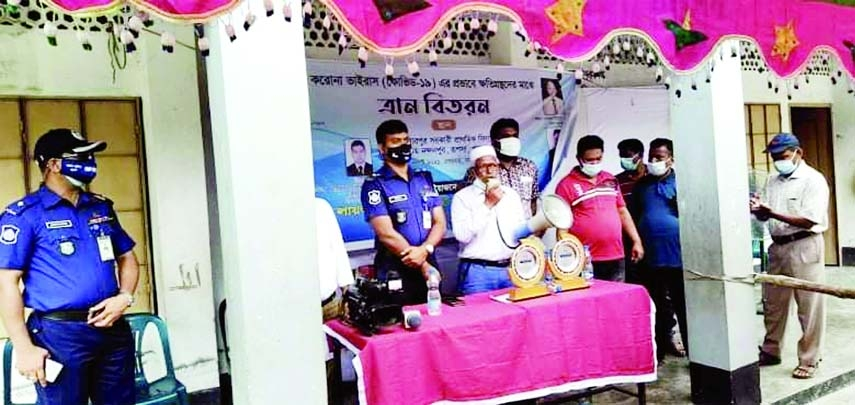 Lion Kazi Akramuddin Ahmed, Director of Lions Club of Dhaka Capital Garden International  speaks in a foodstuff distributing meeting at West Nandanpur in Rupsha upazila of Khulna district recently while Police Superintendent of Khulna  Mohammad Mahbub Hasan attended as  the Chief guest.