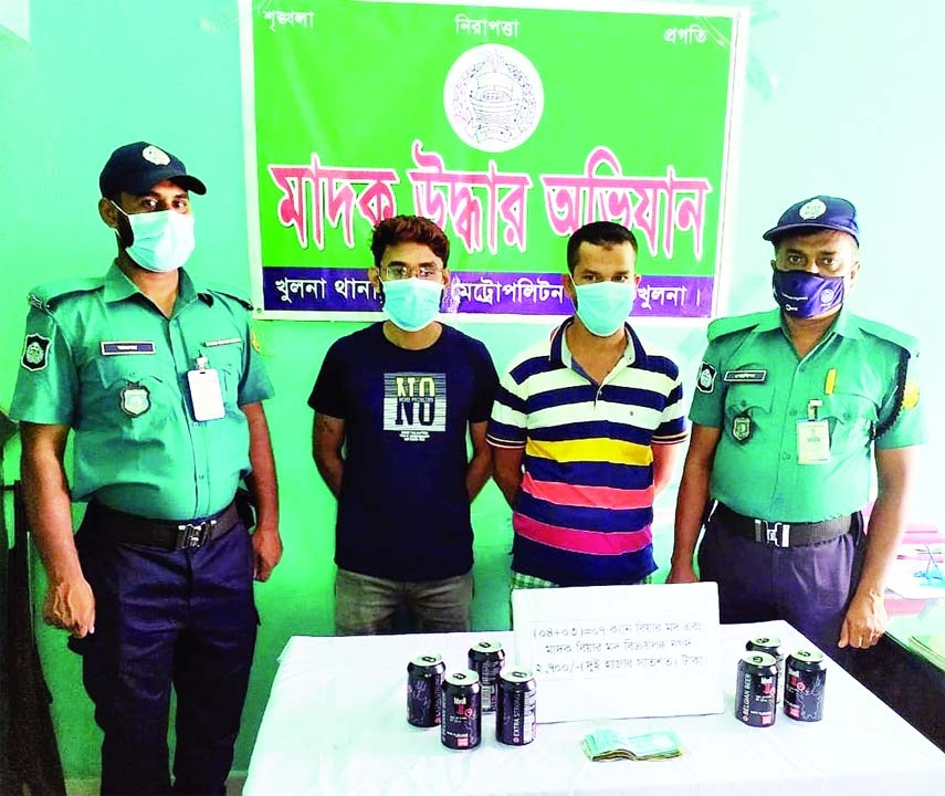 Members of Khulna Kotwali police station arrest two drug peddlers with 7 Cans of Beer from in front of a Hair Dresser in the city's KD Ghosh road area on Sunday.