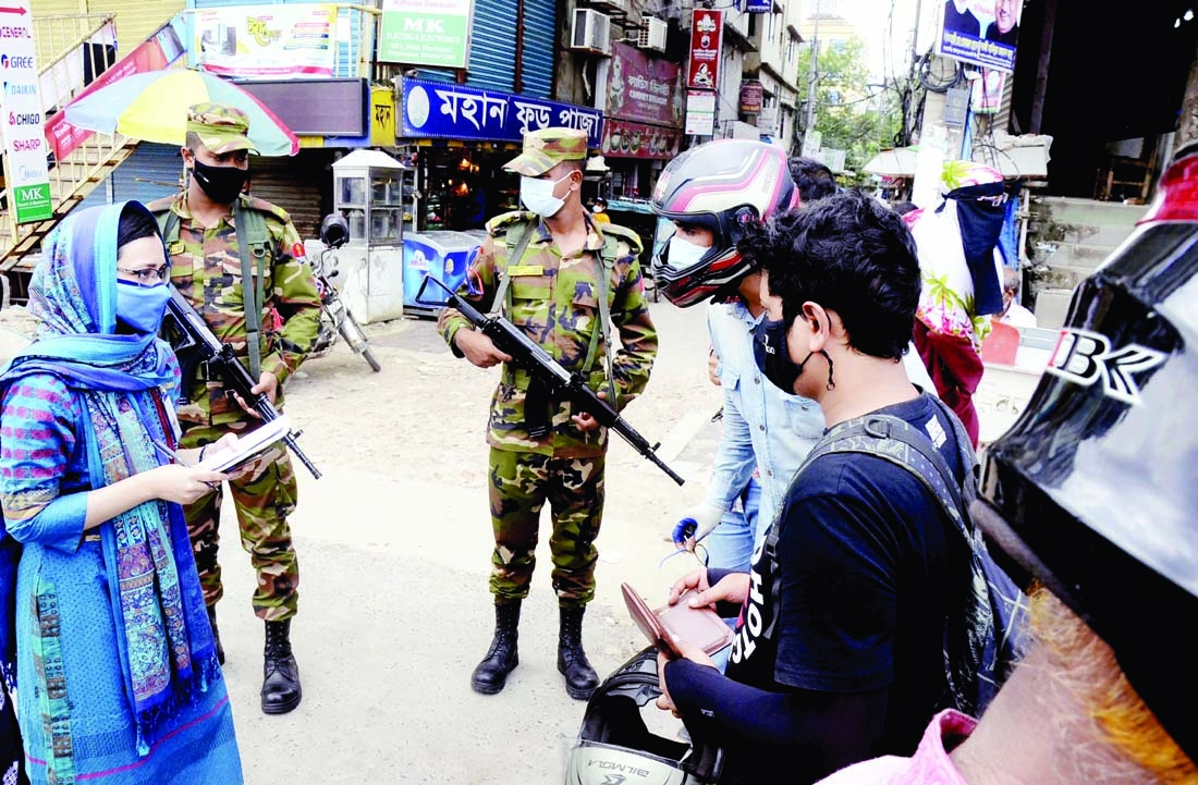 Army personnel conduct mobile court in the city's Dholaipar area on Monday with a view to making lockdown a success.
