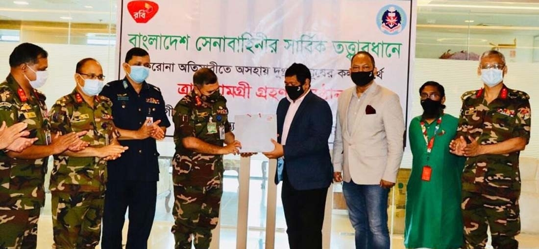 Shahed Alam, Chief Corporate and Regulatory Officer of Robi, handing over a significant number of packets comprised with essential food items to Major General Mohammed Saidul Islam, Chairman of Sena Kalyan Sangstha (SKS) for underprivileged people affected by Covid-19 pandemic across the country to at the SKS head office in capital recently. Brigadier General Md. Mustafa Kamal, DG of SKS and other high officials from both sides were present.