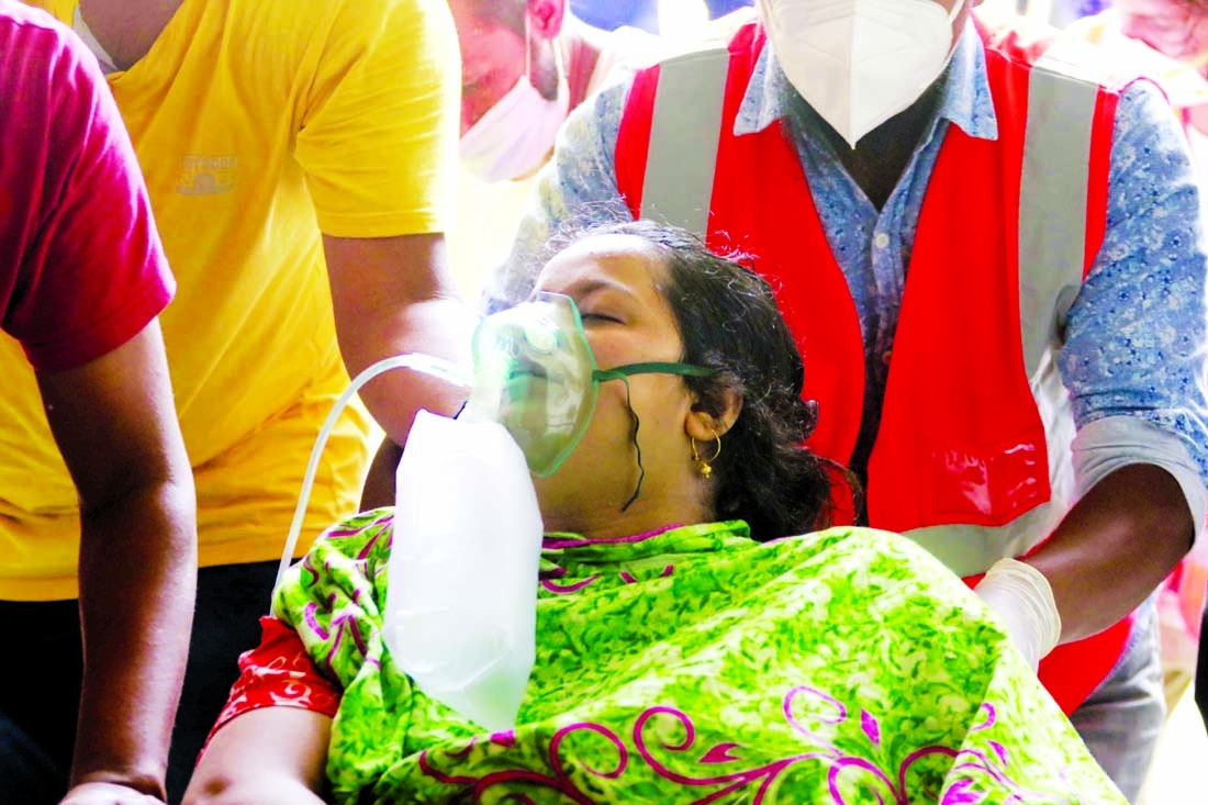 A Covid-19 patient being brought to Dhaka Medical College  Hospital on Tuesday with oxygen support.