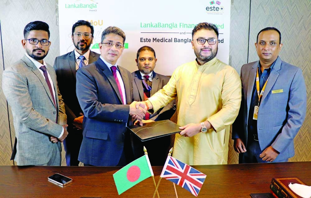 Md. Minhaz Uddin, Head of Cards of LankaBangla Finance Limited (LBFL) and Mohammed Faisal, Managing Director of Este Medical Bangladesh, exchanging document after signing a MoU for their respective organizations recently. Under the deal, card member of LBFL will enjoy up to 10% discount or EMI facility up to 12 months @ 0% interest under ezypay scheme from the medical center. Top officials from both sides were present.