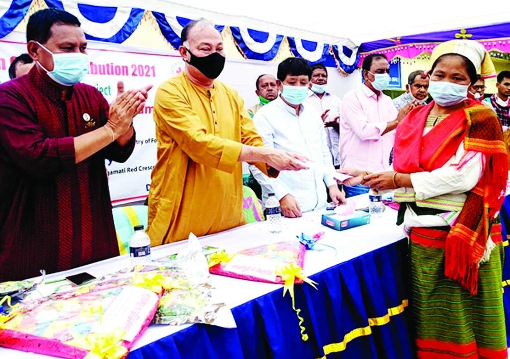 Dipankar Talukdar, MP, distributes cash assistance among the beneficiaries at a function held at Debdarchari in Rangamati on Monday.