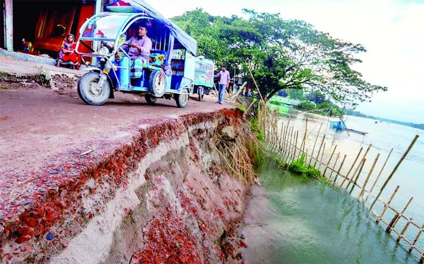 Vast swathes of land eroded by Kaliganga River in Bashertek area in Manikganj after monsoon.
