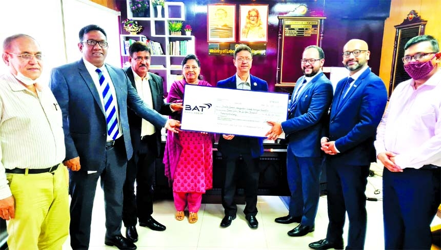 Representatives of the British American Tobacco (BAT) handing over cheque to Md Ehsane Elahi, Secretary of the Labour and Employment Ministry, for Bangladesh Workers' Welfare Foundation Fund at the latter's office in Bangladesh Secretariat on Thursday.