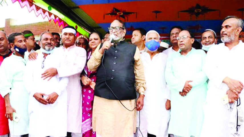 Nuruzzaman Biswas, MP from Pabna-4 constituency speaks at a mass reception program organized to honour him at Muladuli of Ishwardi on Friday.
