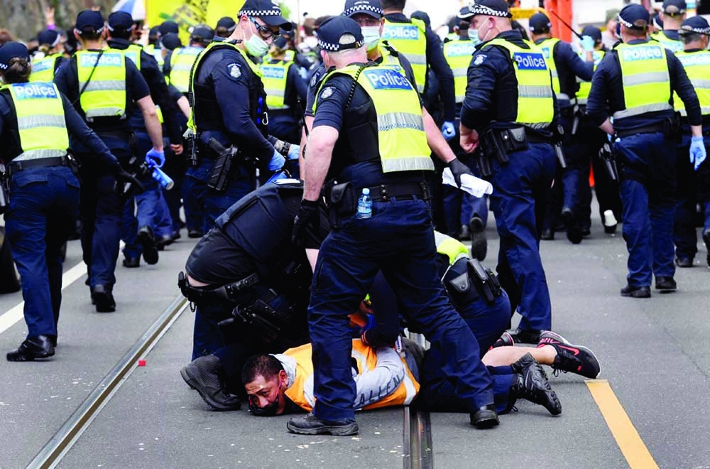 Australian police clash with anti-lockdown protesters