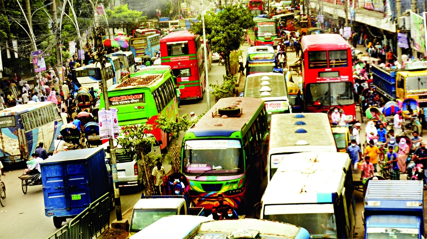 Hundreds of vehicles get clogged at Nayabazar area in the capital on Sunday.