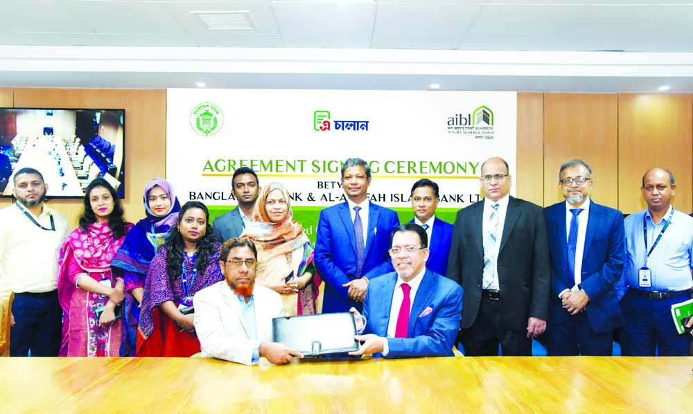 Farman R Chowdhur, Managing Director and CEO of Al-Arafah Islami Bank Limited (AIBL) and General Manager of Accounts and Budgeting Department of Bangladesh Bank (BB), exchanging document after signing an agreement on Automated Challan System (ACS) at BB head office recently. Under the deal, all the branches and sub-branches of AIBL will now be able to collect passport Fees, VAT, tax, and other government fees using ACS. BB Deputy Governor Ahmed Jamal and other senior officials from both sides were present.
