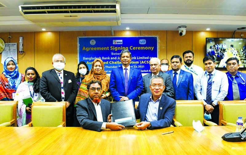 Md.Abdus Salam Azad, MD and CEO, Janata Bank Limited and Md. Forkan Hossain, General Manager of Bangladesh Bank (BB), exchanging document after signing a MoU on Automated Challan System (ACS) at BB head office in the capital recently. Ahmed Jamal, Deputy Governor, Nurun Nahar, Executive Director of Bangladesh Bank and other senior officials from both sides were present.