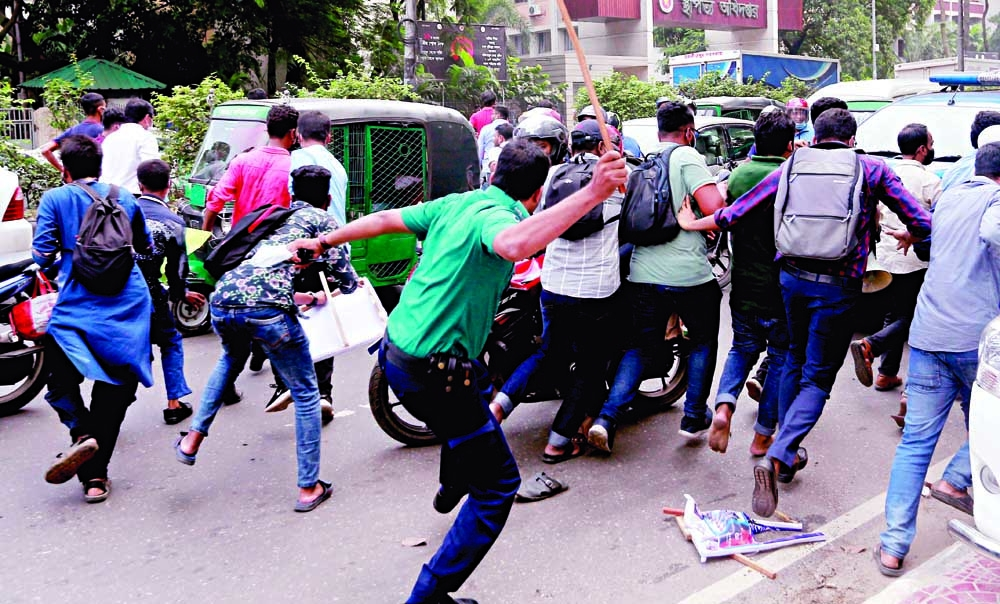 Police charge baton  to disperse protest by deceived Eorange customers who were attempting to occupy the Matsyabhaban intersection on Thursday.