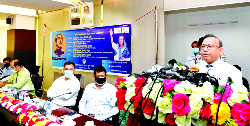 LGRD and Cooperatives Minister Tajul Islam speaks at a seminar on 'Water Stagnant in Dhaka City: Problems and Solution' at IEB Council Hall in the city on Friday.