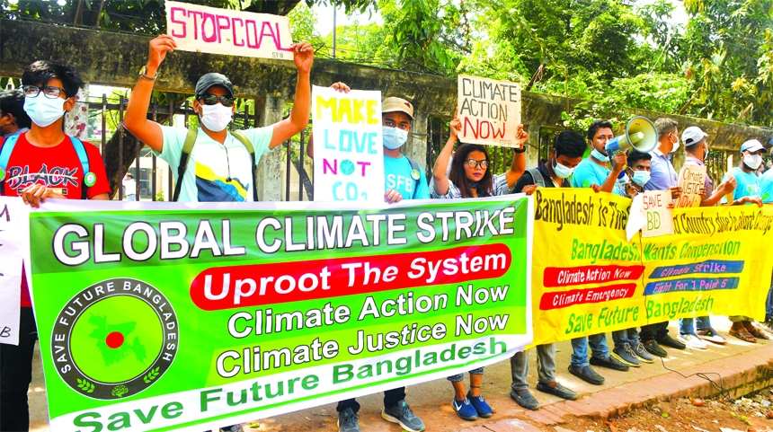 Environmental activists stage a rally in front of the National Press Club in the capital on Friday, seeking global actions to curb adverse impact of climate change.
