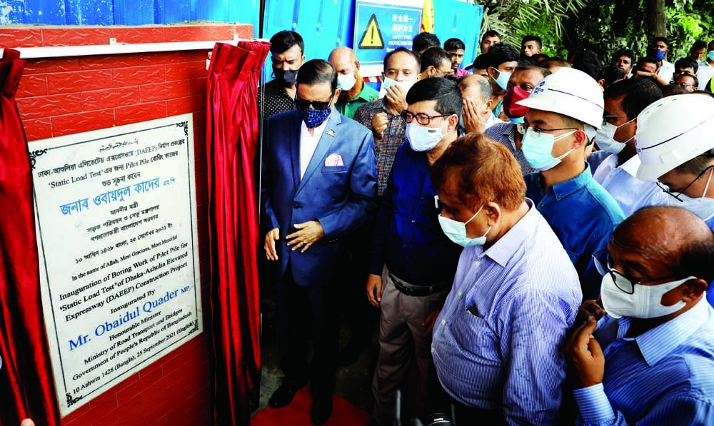 Road Transport and Bridges Minister Obaidul Quader inaugurates pilot piles work of elevated express way at Ashulia in the city on Saturday.