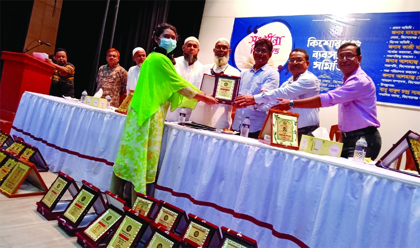 Kishoreganj's Mayor Pervez Miah hands over crests and certificates to 25 brilliant students in a cremony organized by Kishoreganj Marchent Association at Local Art Council Hall on Friday with its President Asaduzzaman Khan Monir presided over.