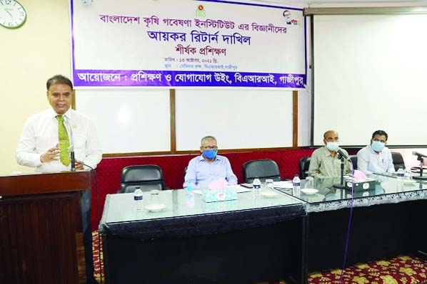 The Training and Communication Wing of Bangladesh Agricultural Research Institute (BARI) has been arranged a training workshop on filing income tax returns for scientists held at the seminar room of the institute today (Wednesday, 13 October 2021). A total of 40 scientists from different levels of BARI, including Chief Scientific Officers and Principal Scientific Officers were participated at the day-long training workshop. BARI Director General Dr. Md. Nazirul Islam addressing the training workshop as chief guest. On the stage (sitting from left) BARI Director (Support & Services) Dr. Md. Kamrul Hasan, Director (Training and Communication Wing) Dr. Muhammad Samsul Alom AND Deputy Tax Commissioner of Gazipur Tax Region Mr. Manjurul Hasan Mehedi.