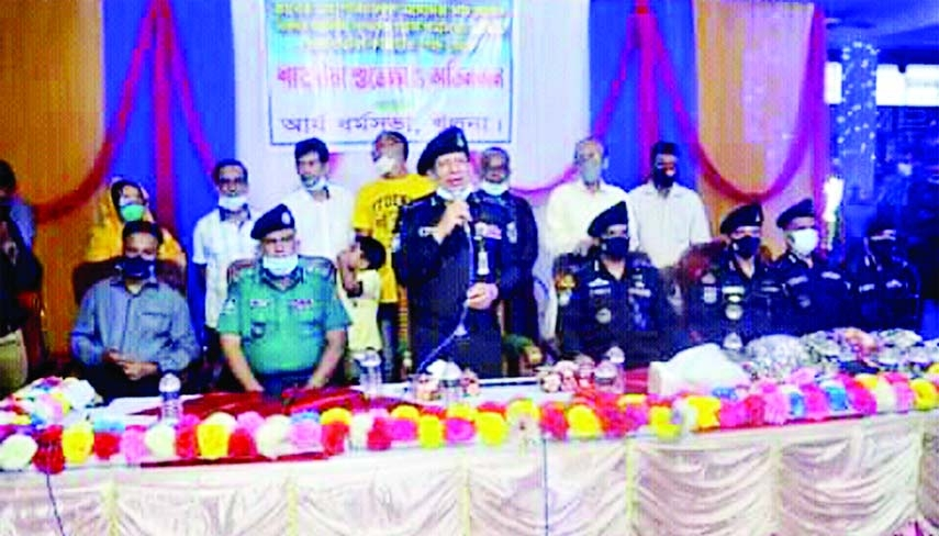 Rab DG Chowdhury Abdullah Al Mamun addresses a meeting as chief guest held at Khulna Arya Dharma Shava temple in Khulna city on the occasion of Durga Puja on Tuesday.